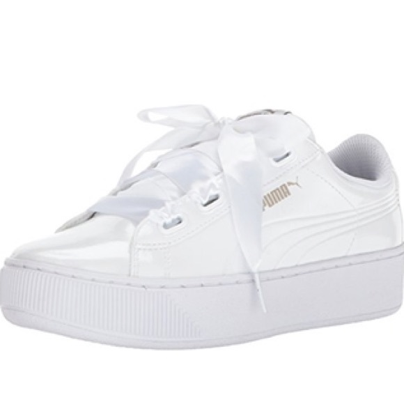 white puma trainers with ribbon